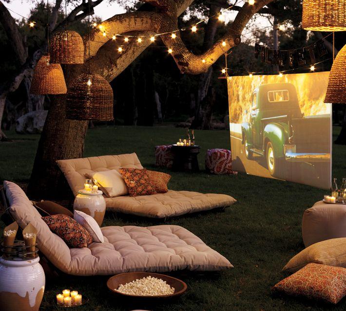 11-outdoor-cinema-with-soft-furishings-and-tree-lighting