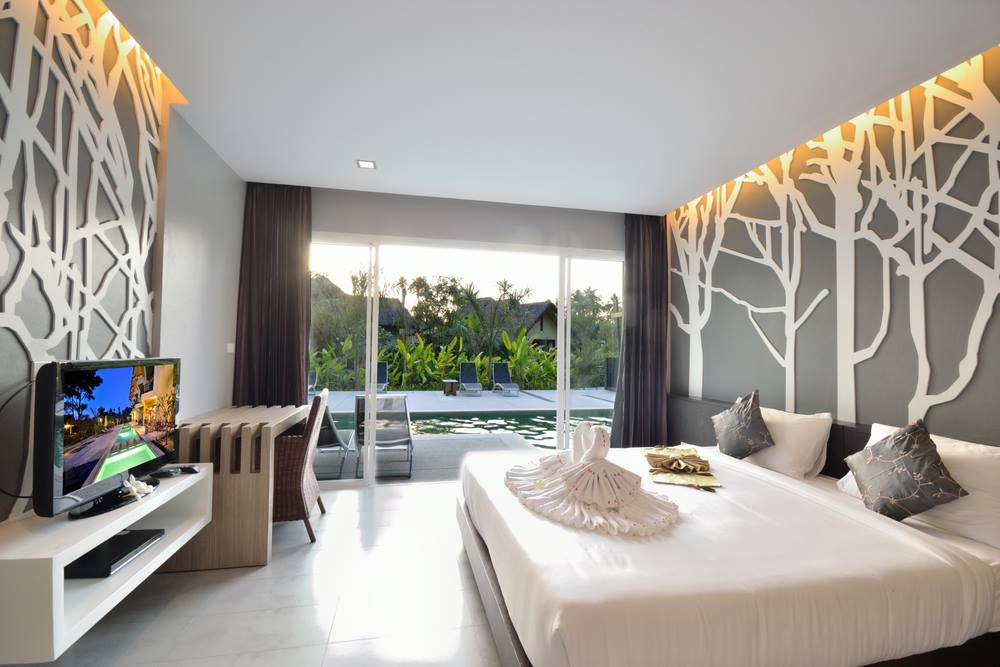 04. An open bedroom with elegant wall decor.