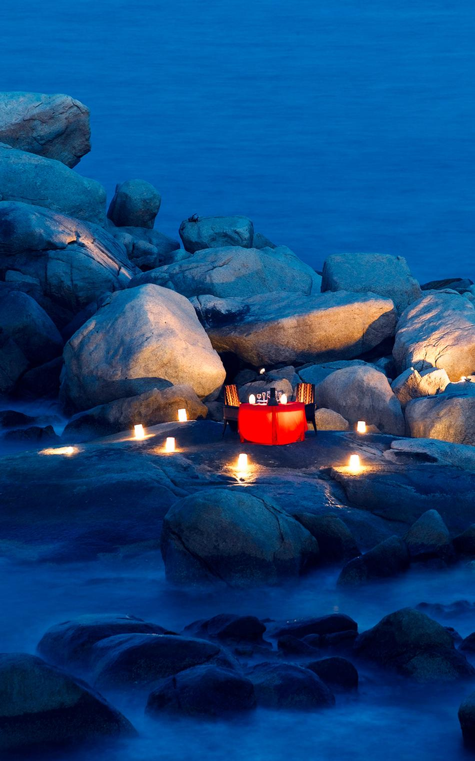 22-lantern-and-candle-lit-dinner-on-a-rocky-shore