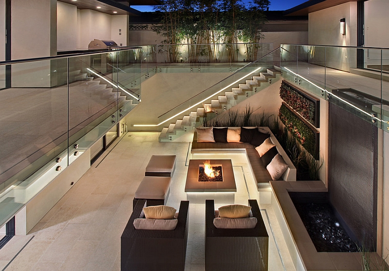24-Outdoor-seating-next-to-the-fire-pit-and-the-waterfall-feature-offers-ample-privacy