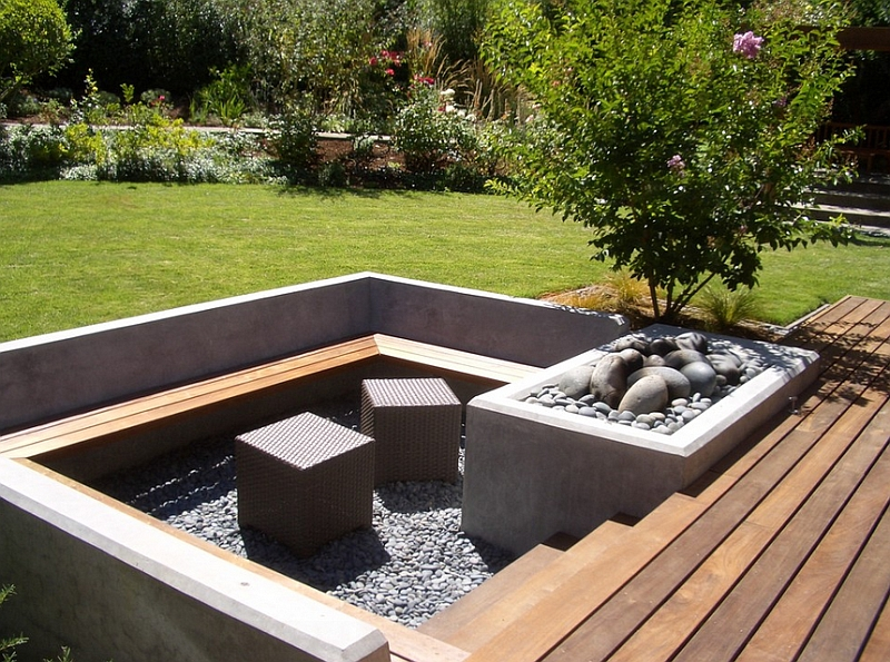 6-Cube-ottomans-add-a-touch-of-contemporary-style-to-the-sunken-seating-along-with-the-firepit