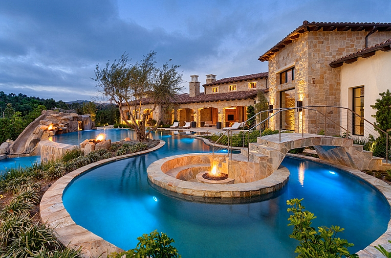 8-Fire-pit-at-the-heart-of-the-pool-with-sunken-seating-around-it-and-a-beautiful-bridge-leading-the-way