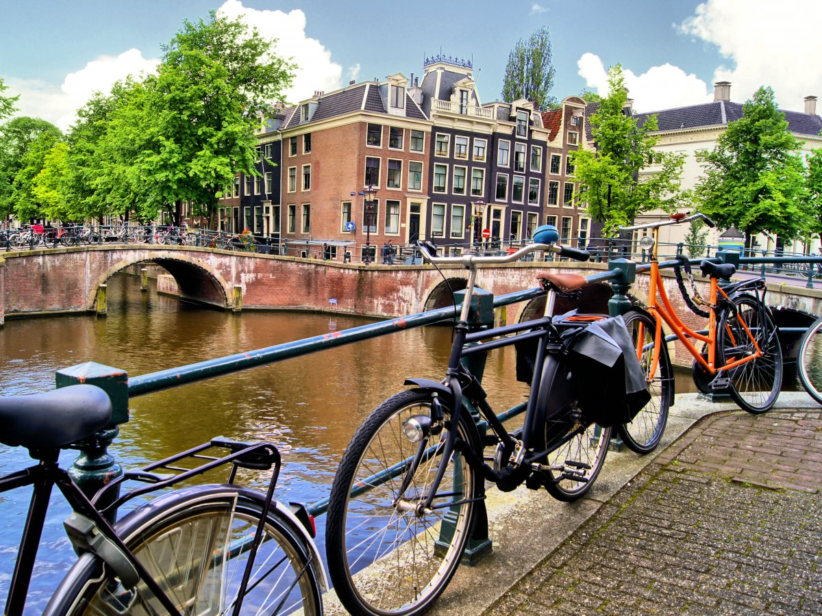 Bike alongside the canals of Amsterdam, the Netherlands.