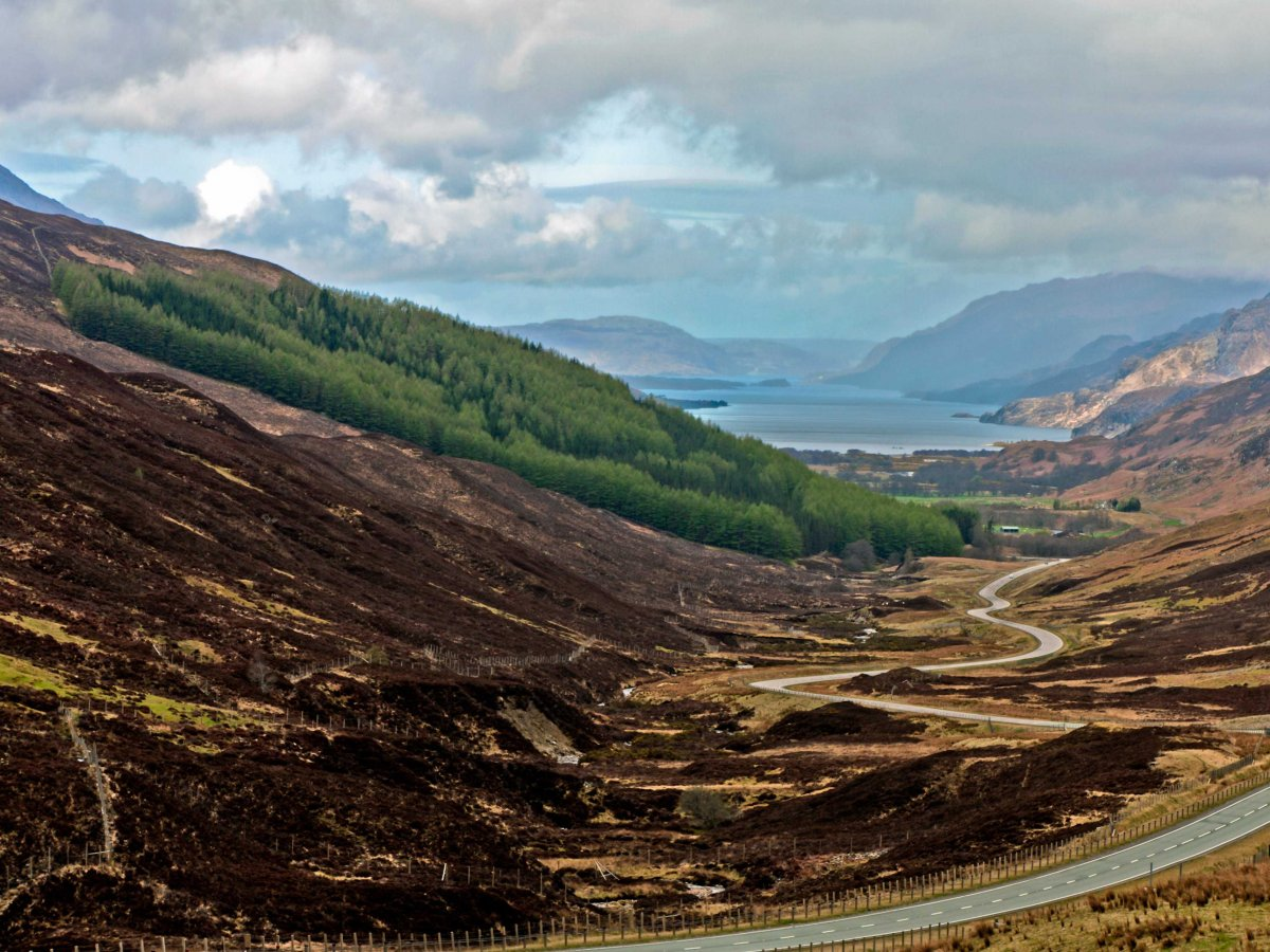 Drive through Scottish Highlands and admire the gorgeous hilly terrain.