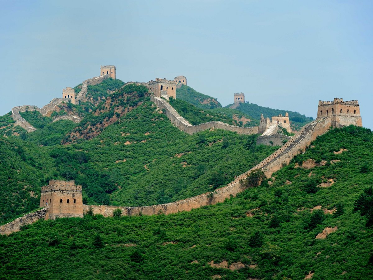 Get adventurous and hike along the unrestored section of the Great Wall of China.