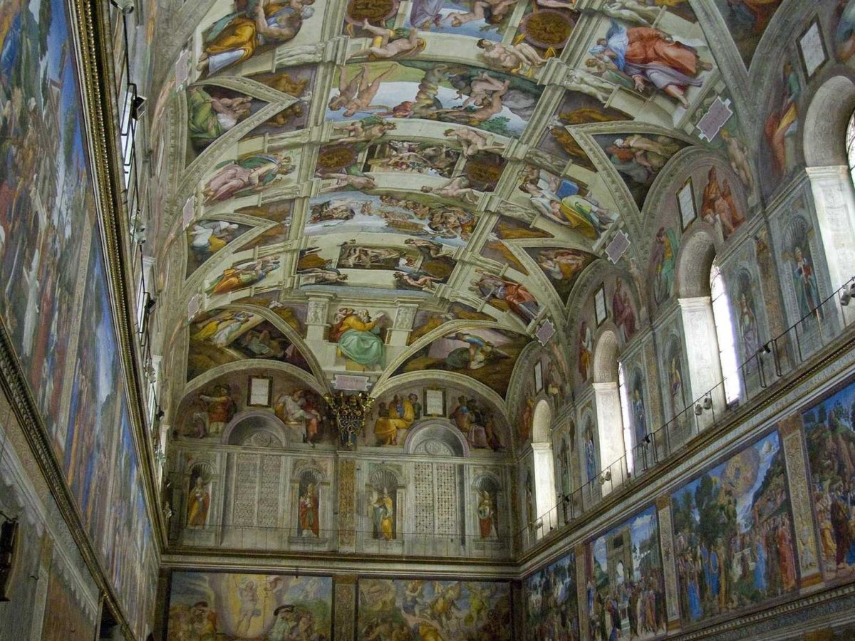 Marvel at the ceiling of the Sistine Chapel in Vatican City.