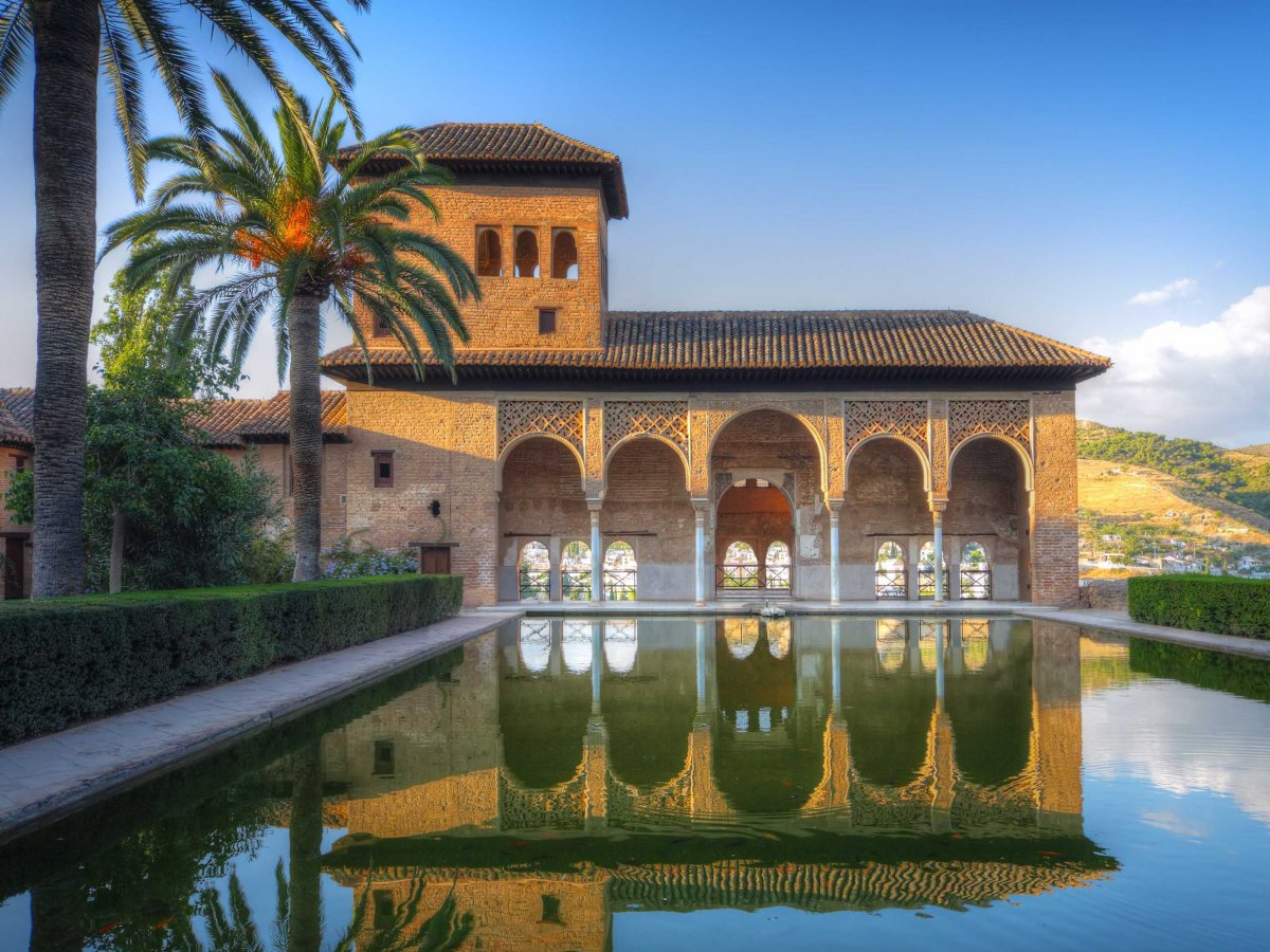Marvel at the Moorish architecture and tranquil gardens of the Alhambra palace in Granada, Spain.