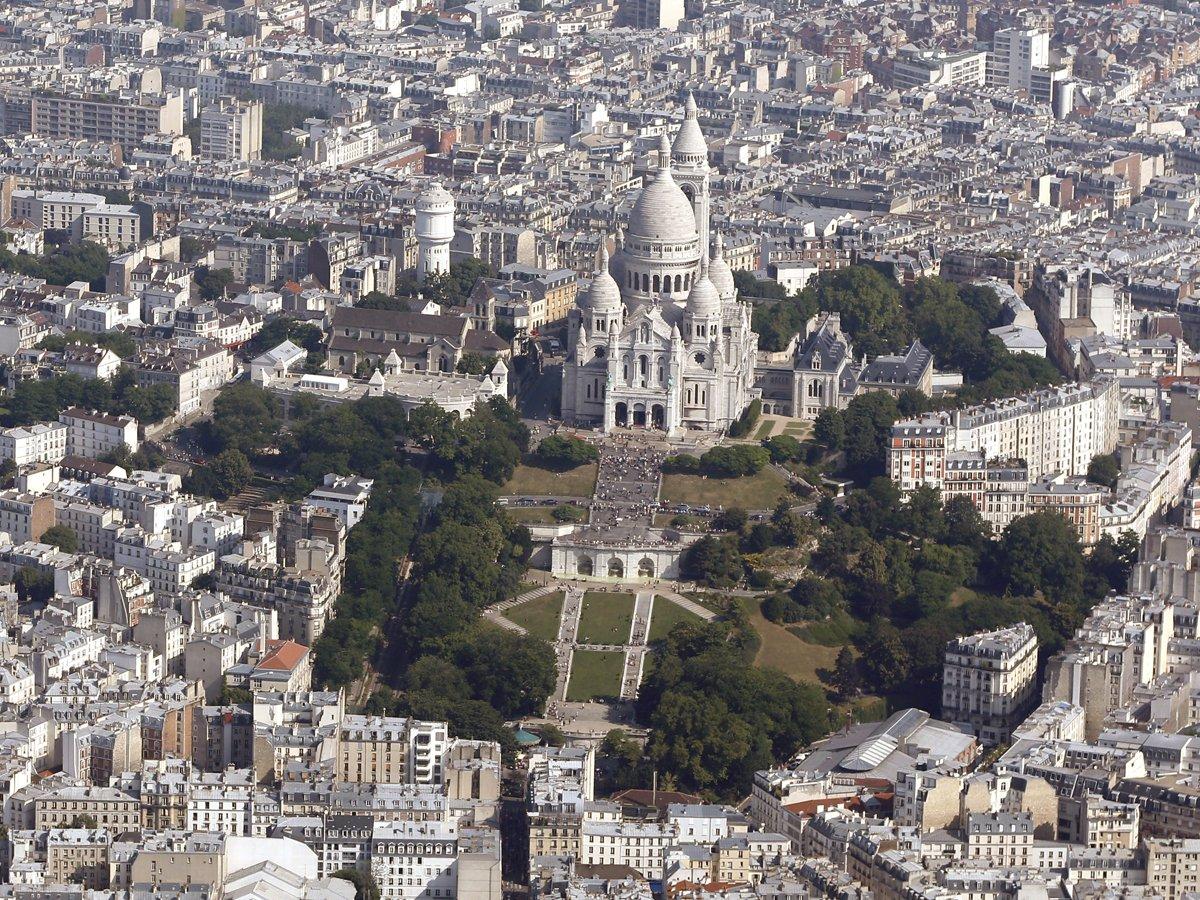 Skip the lines at the Eiffel Tower, and take in the view of Paris from the top of the stairs at the Sacre-Couer in Montmartre.