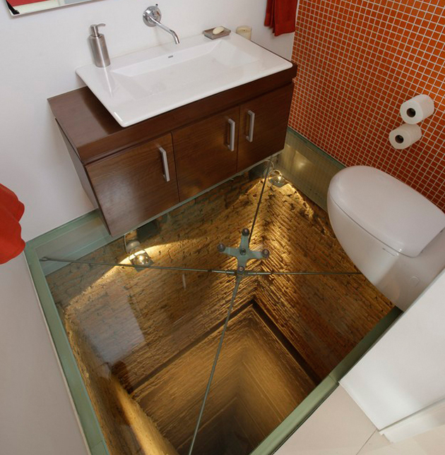 To Spice It Up And Create An Interesting Element, This Glass Floor Bathroom  Won An Irreverent Red Tile Wall.