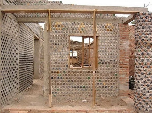 Man builds an amazing house with recycled plastic bottles for House made by waste material