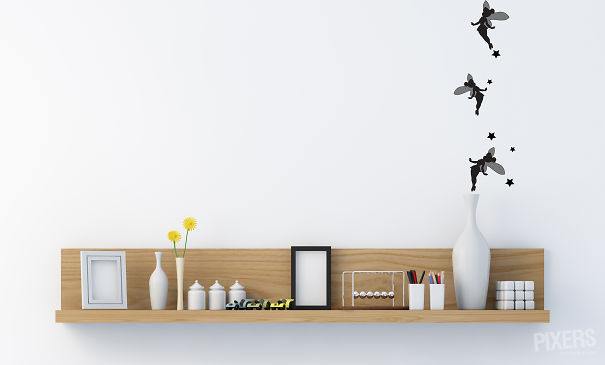 Stylish bookshelf on a white wall