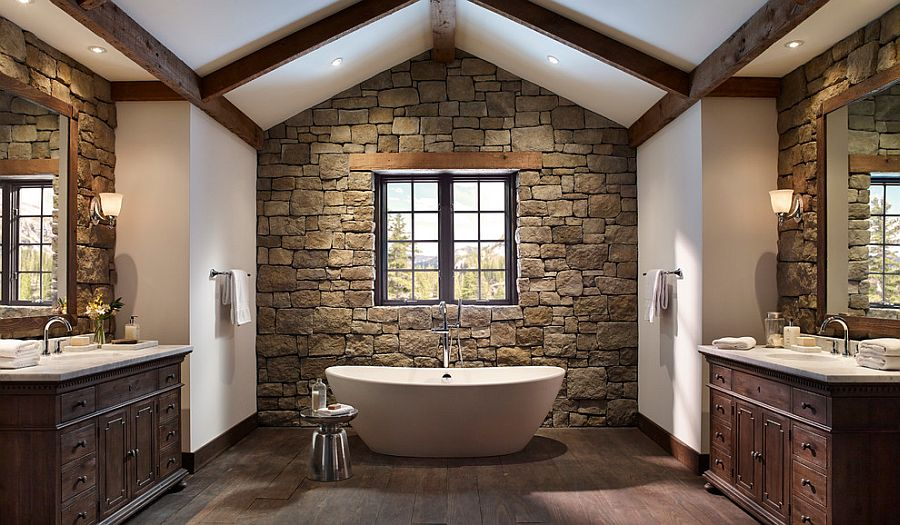 08-AD-Rough-cut-stone-wall-and-wooden-ceiling-beams-create-a-cozy-ambiance-in-the-bathroom