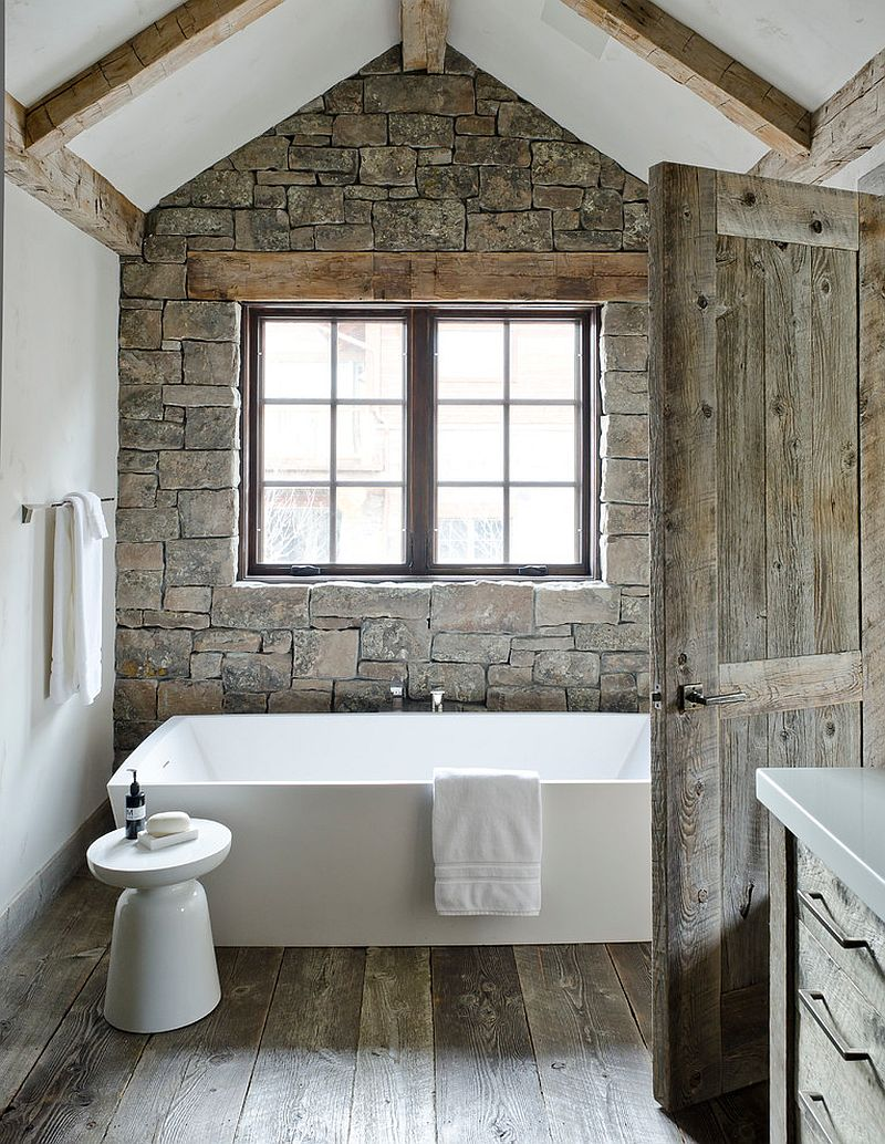 09-AD-White-standalone-bathtub-with-Martini-side-table-and-a-stone-accent-wall-in-the-bathroom