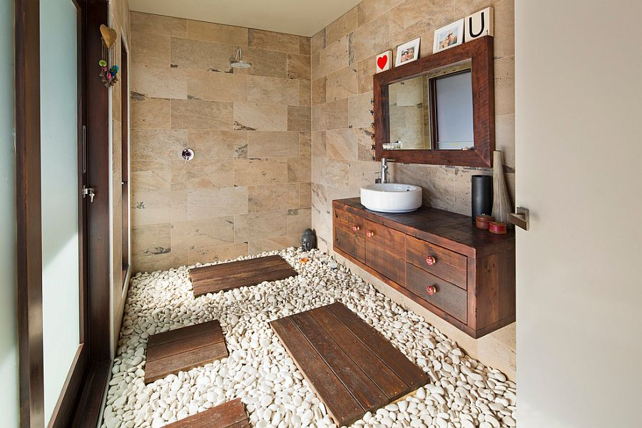 30 exquisite inspired bathrooms with stone walls for Small tropical bathroom design