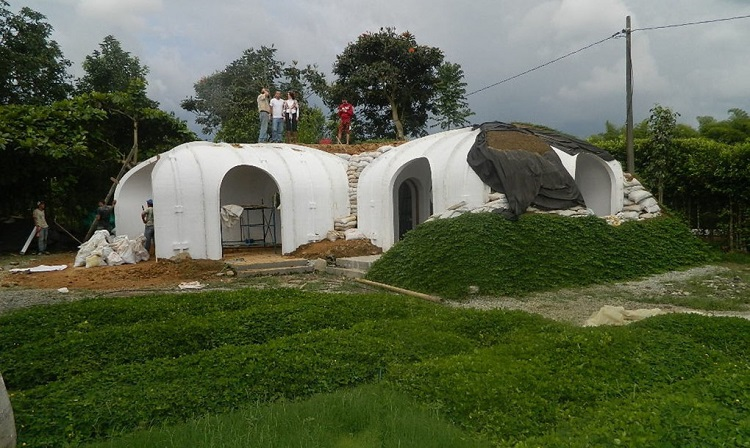 Someone is making pre fab hobbit houses you can actually for Adding onto a manufactured home