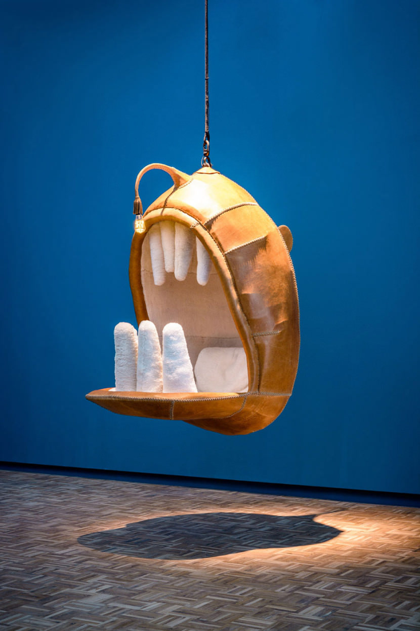 AD-These-Hanging-Chairs-Let-You-Sit-In-The-Mouths-Of-Animals-01