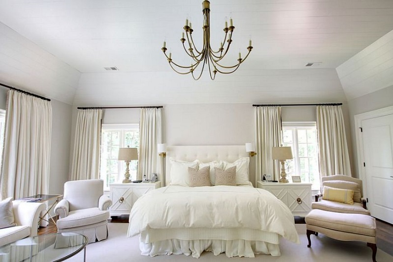 AD Feminine Inspired Bedroom With A Brass Chandelier